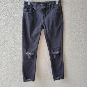 Free People black ripped knee skinny jeans